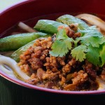 Dan Dan Mien noodles in a bowl with vegetarian meat and other toppings